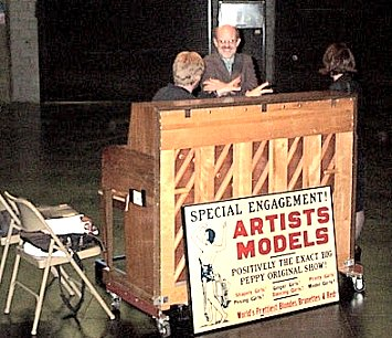 In front of the piano was an old poster that says, Artists Models, a stage extravaganza.